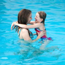 Parent and child in pool
