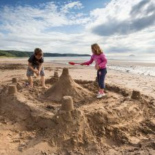 Children making a sand castle