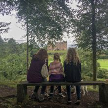 Family time - People on bench looking at Drumlanrig Castle