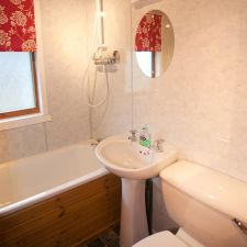 Bathroom with toilet, sink and shower over bath